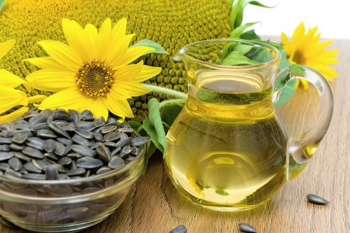 Sunflower Oil And Sunflower Flowers Close-up